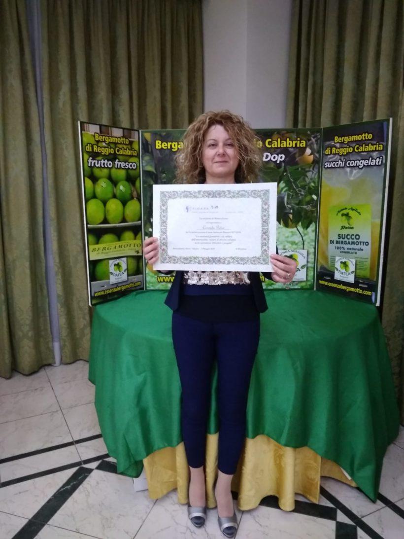 Convegno F.I.D.A.P.A. Premiazione dell'Imprenditrice Carmela Patea